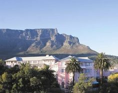 Cape Town, SA - Mount Nelson Hotel with Table Mountain in the background - Explore the World with Travel Nerd Nici, one Country at a Time. http://TravelNerdNici.com