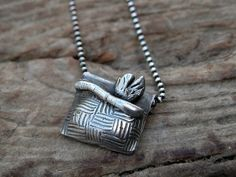 Silver fish in a basket pendant