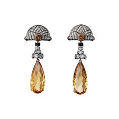 High Jewelry earrings Platinum, two briolette-cut golden imperial topazes totaling 28.11 carats, cabochon-cut colored sapphires, round colored sapphires, obsidian, brilliants.