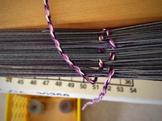 Looking down at the counting string, measuring warp on the warping reel.