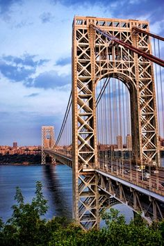 George Washington Bridge, NYC - The George Washington Bridge stands high above the Hudson River, its eastern end resting on the shores of Manhattan, its western end embedded in the wooded bluffs of New Jersey's Palisades.