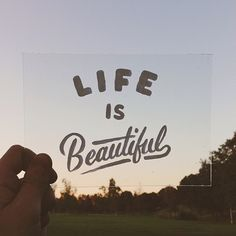 Typeverything.com Life is Beautiful by Sean Tulgetske.  Acrylic, Glass, Landscape, Quote, Photograph, Handlettering, Script, Paint