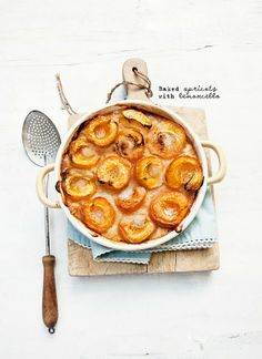 Baked Apricots with Lemoncello - I'm picturing this warm with a dollop of cinnamon sprinkled vanilla ice cream. Mmmm. :)