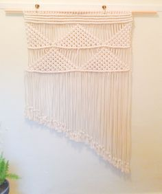 Macrame art inspired by where the mountains meet the sea.  Handmade by Melissa Jean Made.
