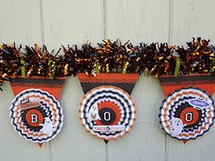 Halloween Banner used making paper medallions and punched circles, chipboard letters and halloween embellisments. The top of each banner piece uses a Martha Stewart Spider Web Border punch