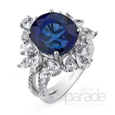 from Parade DesignA sparkling mix of pear and marquis cut diamonds dance around an intense 12.12 carat blue sapphire.