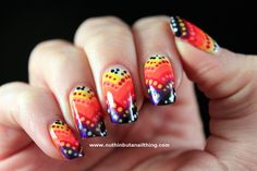 Sunset colored nails with polka dots.