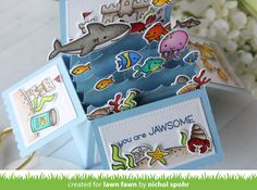 Nichol  created an amazing ocean-themed pop-up card combining our new Duh-nuh  set withlots of different fishy sets! Watch how she made it...