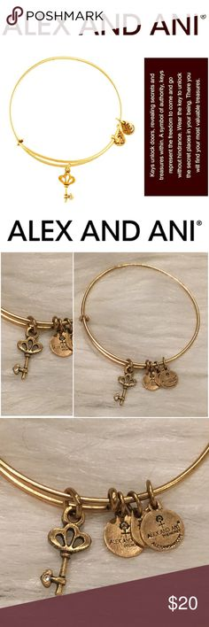 """Alex and Ani Skeleton Key Expandable Wire Bangle Representing power, choice and liberation, dainty logo charms complement the burnished key pendant on an expandable bangle that easily adjusts to the perfect fit. Mix and match multiple Alex and Ani styles for a playfully eclectic look.  Keys unlock doors, revealing secrets and treasures within. A symbol of authority, keys represent the freedom to come and go without hindrance. Adjustable; 3/8"""" - 3/4"""" charm diameter. goldtone plate. By Alex…"""