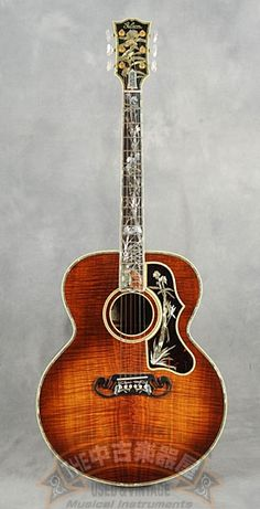 Gibson 100th Anniversary Custom SJ-200 (1994) : Gibson's master luthier Ren Ferguson produced 4 gorgeous SJ-200s to celebrate their 100th anniversary. This is one of them with curly koa.