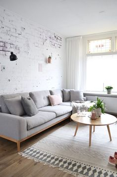 Gorgeous simple little Scandinavian style living space.