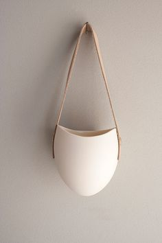 porcelain and leather hanging planter                                                                                                                                                                                 More