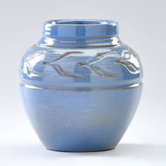 """FLORA HUCKFIELD; NORTH DAKOTA SCHOOL OF MINES Glazed ceramic vase incised with leaves at shoulder, Grand Forks, ND; Indigo stamp, incised with artist's cipher/95A; 5"""" x 4 1/4"""" dia."""