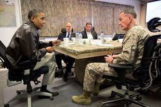 PRESIDENT BARACK OBAMA receives a briefing from Gen. Joseph F. Dunford, Jr., Commander of International Security Assistance Force and United States Forces-Afghanistan, at Bagram Airfield, Afghanistan, Sunday, May 25, 2014. Seated across the table from left are James Cunningham, U.S. Ambassador to Afghanistan, and Jeff Eggers, Senior Director for Afghanistan and Pakistan, right.