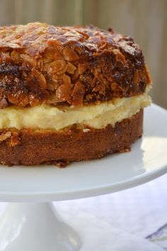 Bienenstich (Bee Sting Cake) German dessert -  Bun-like cake with a creamy custard filling and a caramelized almond topping. www.myfamilykitchen.net
