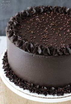 "Triple layer Chocolate Cake - incredibly moist and chocolatey! I think I might try this since Duncan Hines ""downsized"" its cake mixes and they look stingy when they're baked and frosted."