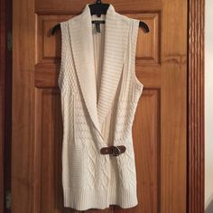 Ralph Lauren Sweater Cream colored sleeveless sweater with brown belt and silver hardware. Never worn. Excellent condition. Size L. Ralph Lauren Sweaters