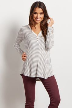 Stripes just got cuter with this soft henley maternity top. Show off your growing bump in style with these soft hues and flattering cut. Perfect for a casual day out when paired with your maternity jeans or leggings and comfy flats.
