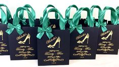 Elegant 25th Birthday celebration gift bags with emerald green satin ribbon handles, bow and gold custom print. Personalized party favors for guests #partyfavors #partyideas #partygifts #favorbags #favorsforwedding #favorideas #favors #anniversaryparty #birthdayparty #giftbags #personalizedgift #birthdaycelebration #fiftyandfabulous #fiftyandfantastic #30thbirthday #40thbirthdayparty #25thbirthday #elegantparty #blackandgold #goldparty