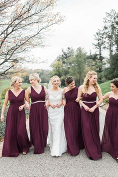 Fall wedding, burgundy dresses at country club
