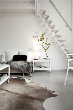 Slide 9 - White staircase on white wall background looks neat and uncluttered. The room has been accessorized vwell with other neutral colored decors.