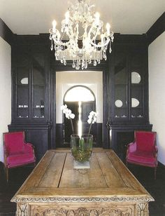 black built ins, white walls, farmhouse table and pink chairs.  real good y'all.