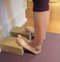 Spend five minutes stretching your feet on wood bricks and your feet and calves will thank you. You can also do this with a rolled up yoga mat.