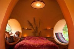 Just six weeks and $9K built this mango-colored dome home dreamy romantic bedroom cocoon egg porthole windows