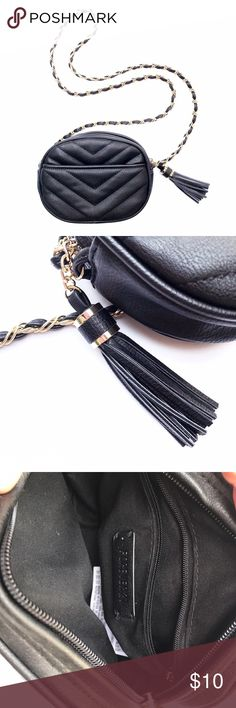"NWOT Black Quilted Tassel Crossbody Bag This black faux leather crossbody bag has chevron stitching, a chain strap, and a tassel. Size: small (~6""). Never used. Forever 21 Bags Crossbody Bags"
