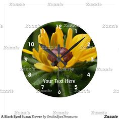 A Black Eyed Susan Flower Round Clock.  From Smilin' Eyes Treasures at Zazzle.