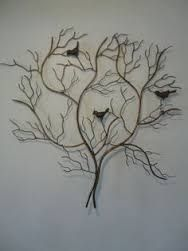 Image result for wrought iron sculptures or art work that can be hung onto garden trellising