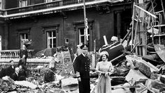 King George VI and The Queen Mother at Buckingham Palace after it was bombed in WWII.