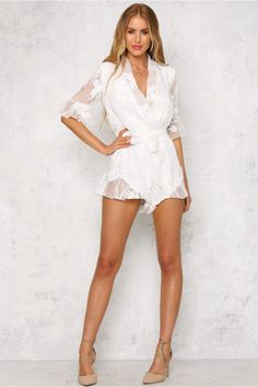 The Shady Palm Playsuit has a deep v-neckline with an elasticated waist and removable tie which can also be used as a choker. The shorts and sleeves have subtle frills, whilst the entire garment is decorated with floral embellishments. Why not layer with a dainty bralet!   Playsuit. Partially lined. Cold hand wash only. Model is standard XS and is wearing XS. True to size. Print may vary in placement.  Non-stretchy fabric. Polyester.