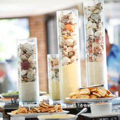 Reception | Tall cylinder vases filled with sand and shells.