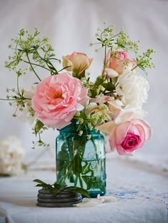 Pink flowers filled in aqua mason jar centerpieces for wedding. Here're some creative ways you can utilize the mason jar wedding centerpieces Mason Jar Centerpieces, Wedding Centerpieces, Wedding Table, Wedding Decorations, Wedding Ideas, Trendy Wedding, Chic Wedding, Simple Centerpieces, Wedding Simple