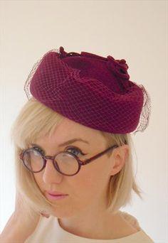 Vintage Burgundy Pill Box Hat Felt with Net Detail https://marketplace.asos.com/listing/hats/burgundy-pill-box-hat-felt-with-net-detail/293212?mode=SavedExisting