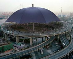 World's Largest Umbrella in Gansu Province, China.------I think it would be much better if there were solar panels on the umbrella. LOL