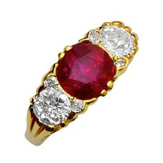 Three Stone Burma No Heat Ruby And Old European Diamond Filigree Ring | From a unique collection of vintage three-stone rings at https://www.1stdibs.com/jewelry/rings/three-stone-rings/