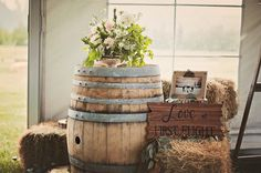 Reception decor idea - wine barrel with fresh flowers and love sign {Relic Photographic}