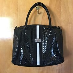 Tommy Hilfiger bag Black Tommy Hilfiger bag.  Width: 12 inches. Height: 10 inches.  Condition: Great condition! Barely used. Tommy Hilfiger Bags