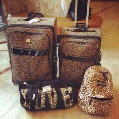 Victorias Secret leopard luggage.