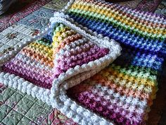Rainbow baby blanket, free pattern by Annette Ziedman of Petunia Pill Crochet & Photography. Very easy pattern of alternating SC & TC stitches. Pic from Ravelry Project Gallery by azshere . . . ღTrish W ~ http://www.pinterest.com/trishw/ . . .   #crochet #afghan #throw