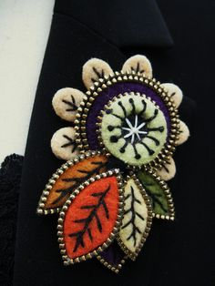 Flower and leaves brooch by woolly  fabulous, via Flickr