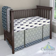 Crib bedding in Windsor Navy Deer Head, Windsor Navy Tribal Herringbone, Navy and White Deer, Solid Charcoal Gray Minky, Gray Arrow, Heather Gray, Navy Quatrefoil. Created using the Nursery Designer® by Carousel Designs where you mix and match from hundreds of fabrics to create your own unique baby bedding. #carouseldesigns