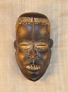 African Masks and statues of the Bete. This African Mask from the Bete tribe of Ivory Coast measures 11 inches tall and 6.75 inches wide and is hand-carved of wood. This example of Bete art is over 50 years old.
