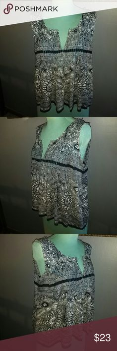 """Free People Shirt Black and Creme floral design rayon blend shirt with a V neckline in front has a open design back with 3 ties across it semi high low hemline style has a raw edge hemline style is 26"""" long great for layering Free People Tops"""