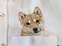 hand embroidered Shiba dog i the pocket on the white linen shirt for men