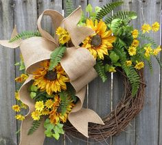 This sunflower wreath is perfect to welcome spring and to use all summer long! Realistic golden sunflower and yellow daisy blooms are complimented