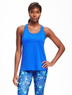 Old Navy Scoop neck. Sleeveless. Exposed elastic racerback strap. Active logo at back. Hi lo hem. Smooth, moisture wicking mesh, with added stretch. Go Dry: superior technology keeps you dry & comfortable. Active is available exclusively at stores and online. Loose fit. Tank hits below waist.