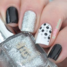 Black and silver manicure with studs. Visit www.lapaloma-boutique.com for studs like those